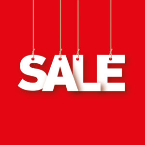 Sale - the word of the white letters hanging on the ropes on a red background